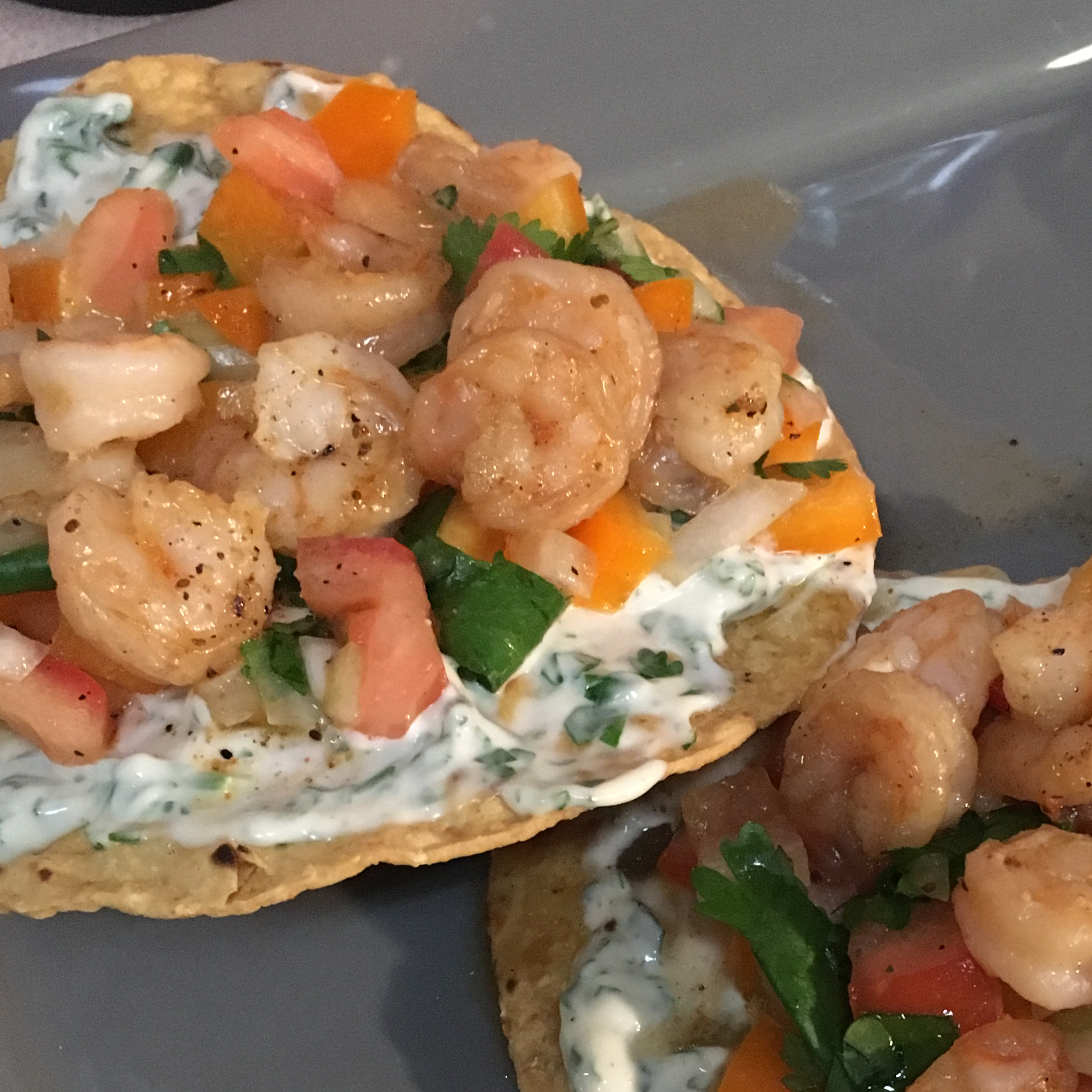 "Quick and easy, these tostadas are layered with homemade salsa, shrimp, and avocado. Shisafest says, ""My aunt wowed me with this simple, yet delicious shrimp tostada recipe. It is very simple to make and everyone asks for more! I use garlic salt for the salt!"""
