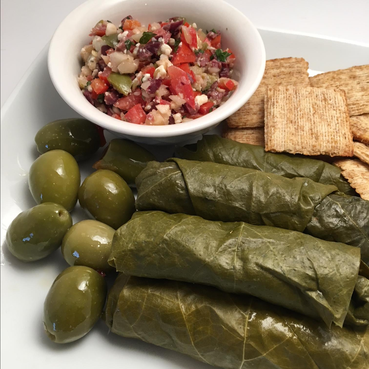 "You'll wrap grape leafs around a mixture of green olives, kalamata olives, Gorgonzola cheese, macadamia nuts, basil, tomatoes, bell pepper, garlic, and a dash of brown sugar. ""These are the richest appetizers we have ever served,"" says LINDA. ""They are wonderful with wine and cheese! Use as much Gorgonzola as suits your taste!"""