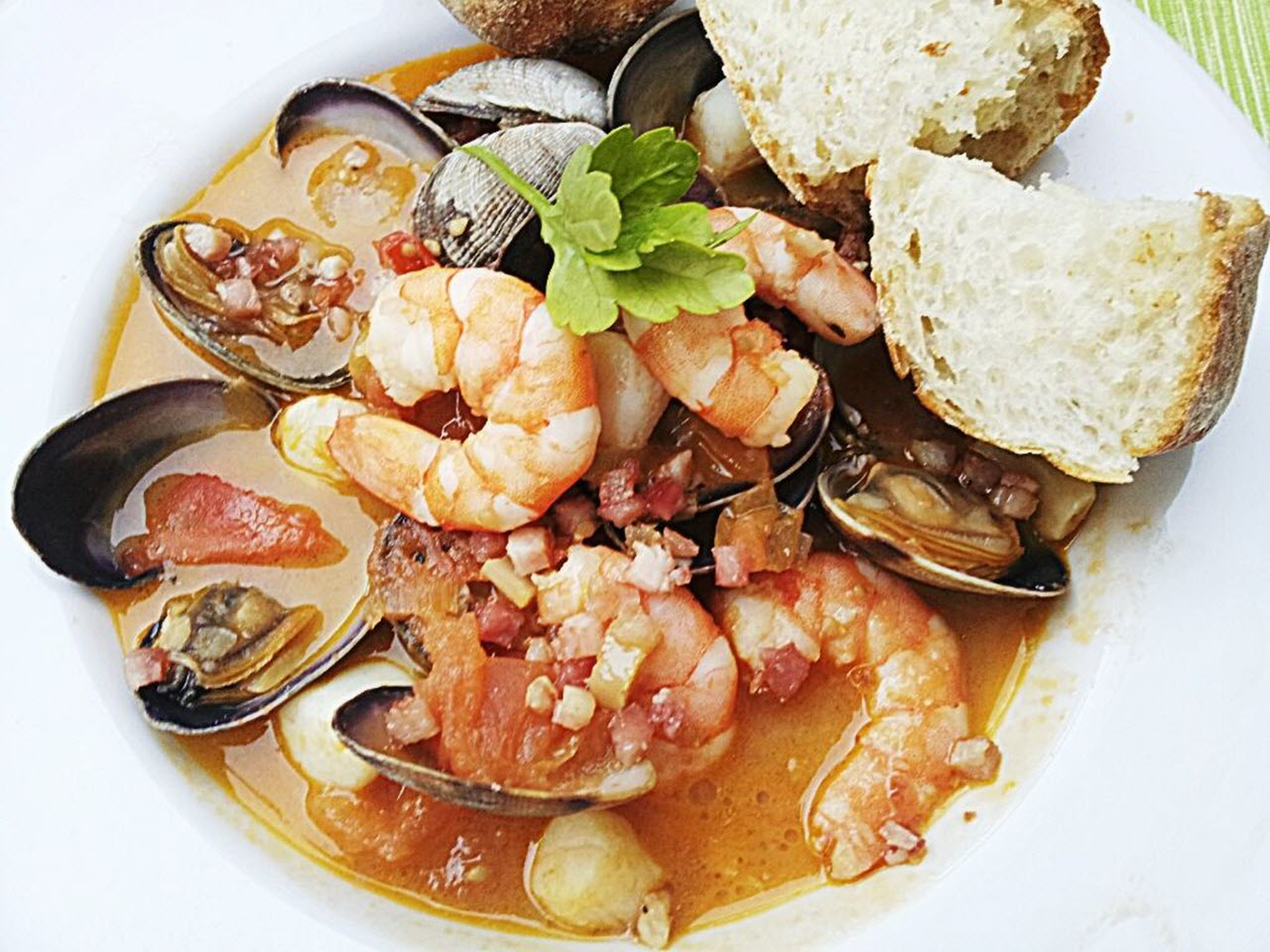 """""""Easy yet tasty fish soup made only with the best fresh Mediterranean fish and seafood,"""" says Giulia. """"Use the remaining fish stock for a seafood risotto."""""""