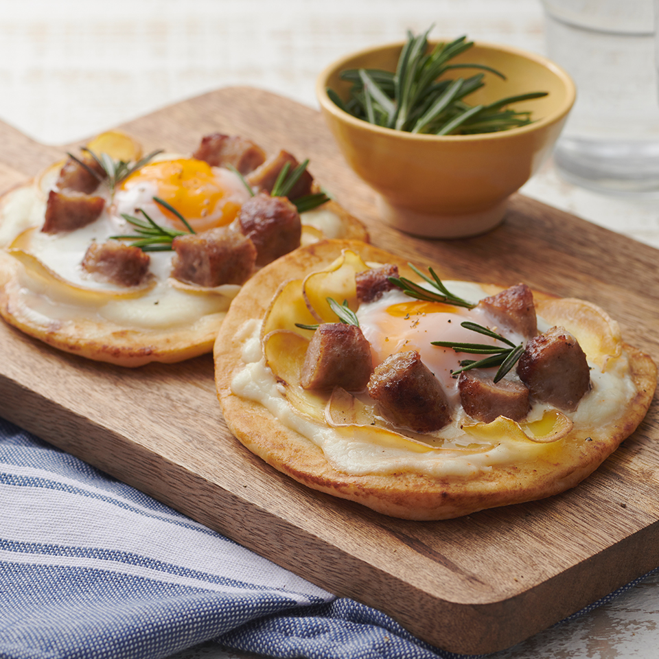 Breakfast Pizza with Sausage, Potato, and Cheese Sauce