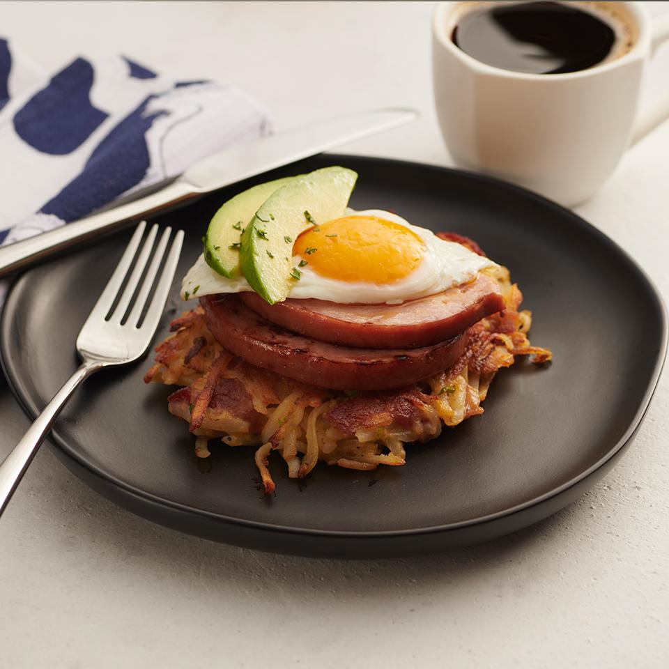 Bacon Potato Cakes with Ham Steak, Egg, and Sliced Avocado