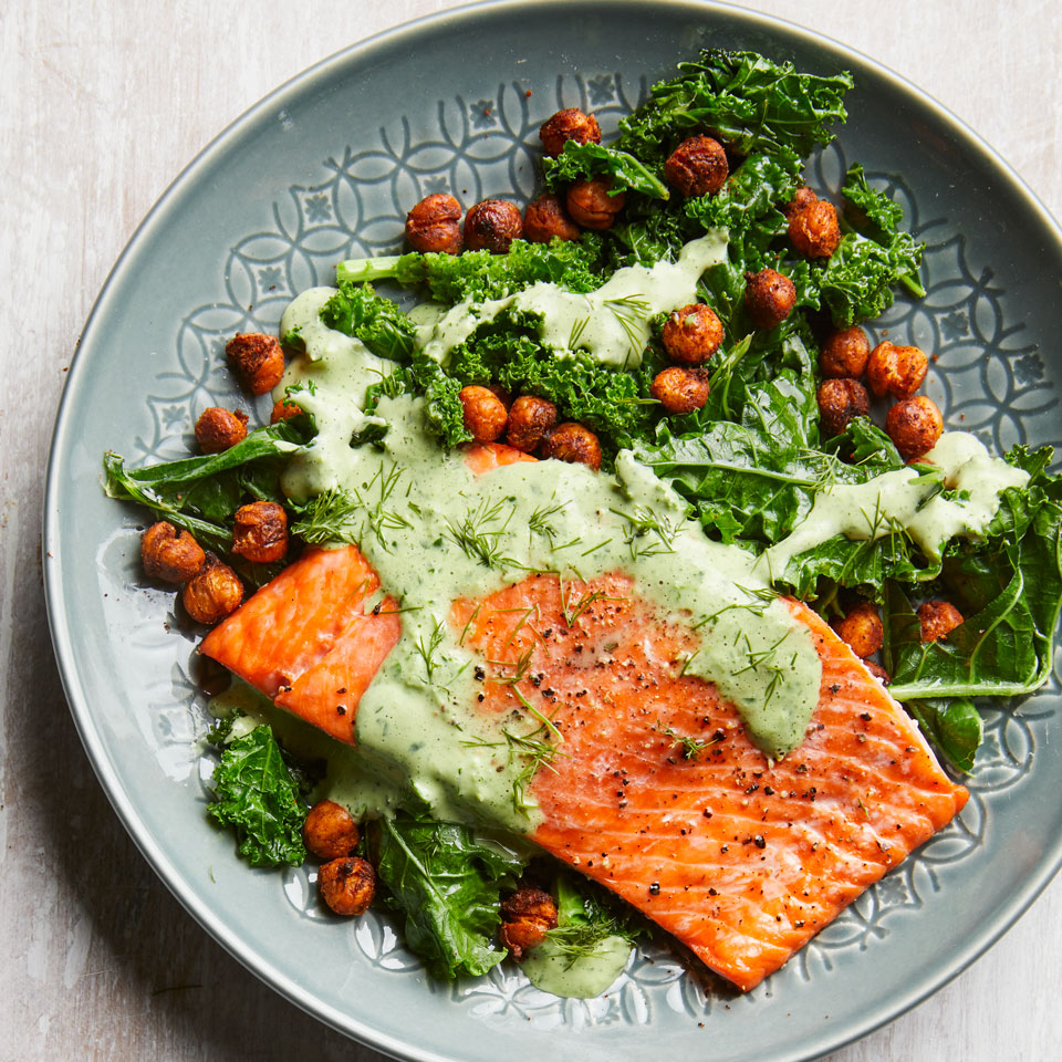 In this healthy salmon dinner, you'll get a dose of greens and green dressing! Chowing down on 6 or more servings of dark leafy greens a week can help keep your brain in top shape. This dish features the Test Kitchen's current go-to method for doctoring a can of chickpeas: spice them up and roast until crispy. Source: EatingWell Magazine, March/April 2018