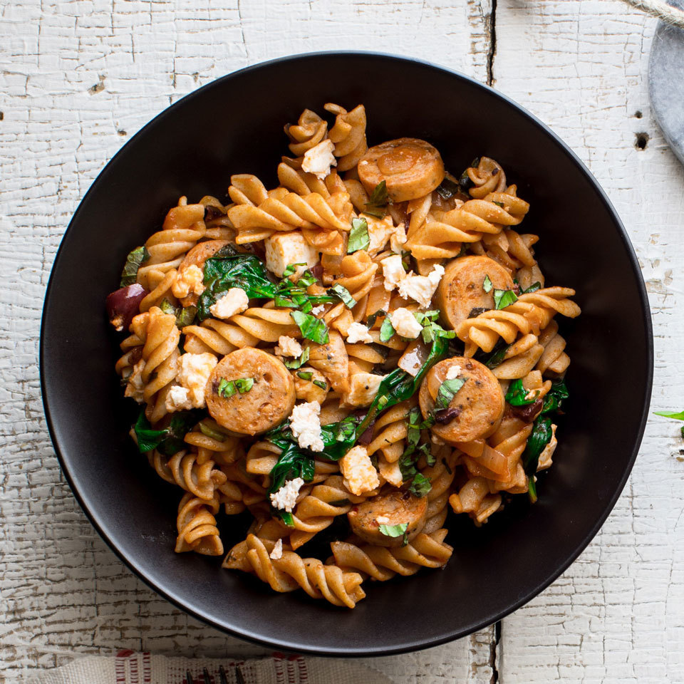 A little bit of Sunday meal prep goes a long way in this one-dish Mediterranean pasta recipe. The pasta is cooked ahead of time and stored in the fridge to use for meals all week, but any leftover cooked pasta you have on hand will do. Chicken sausage with feta is especially good in this recipe. Source: EatingWell.com, February 2018