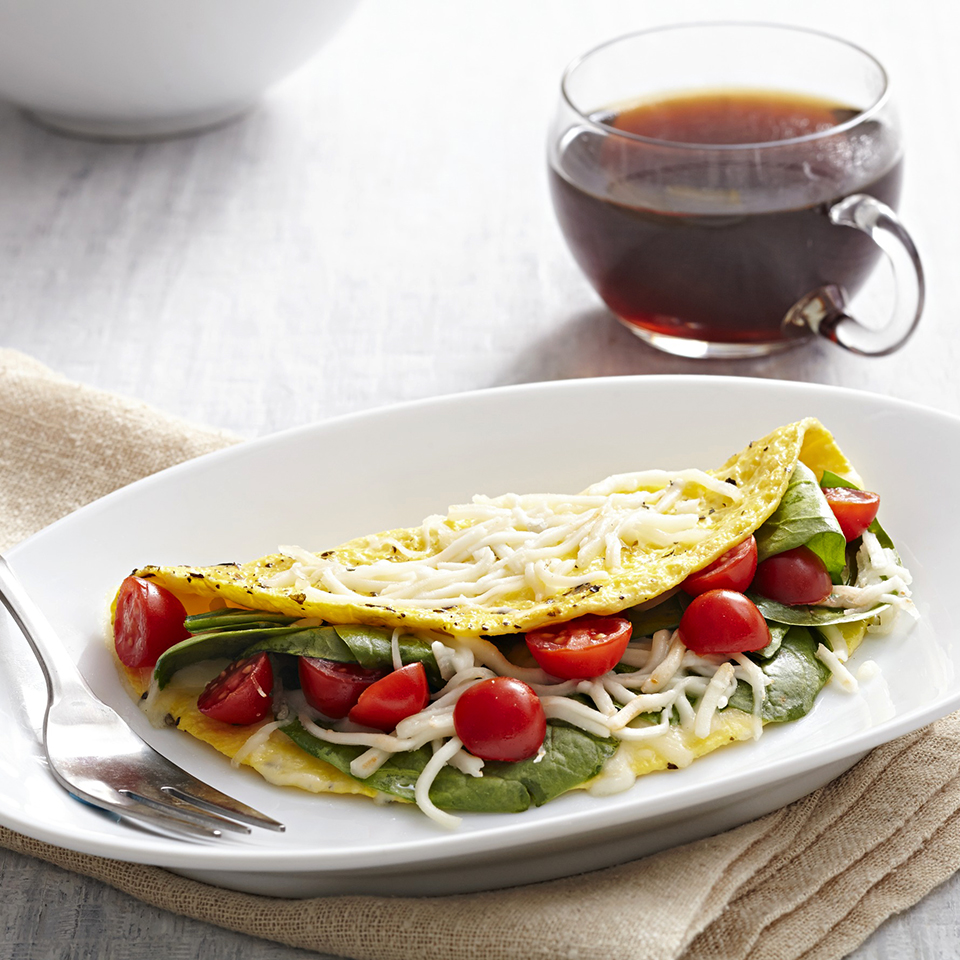 Spinach, tomatoes, and cheese complete this Italian omelet. Source: Diabetic Living Magazine