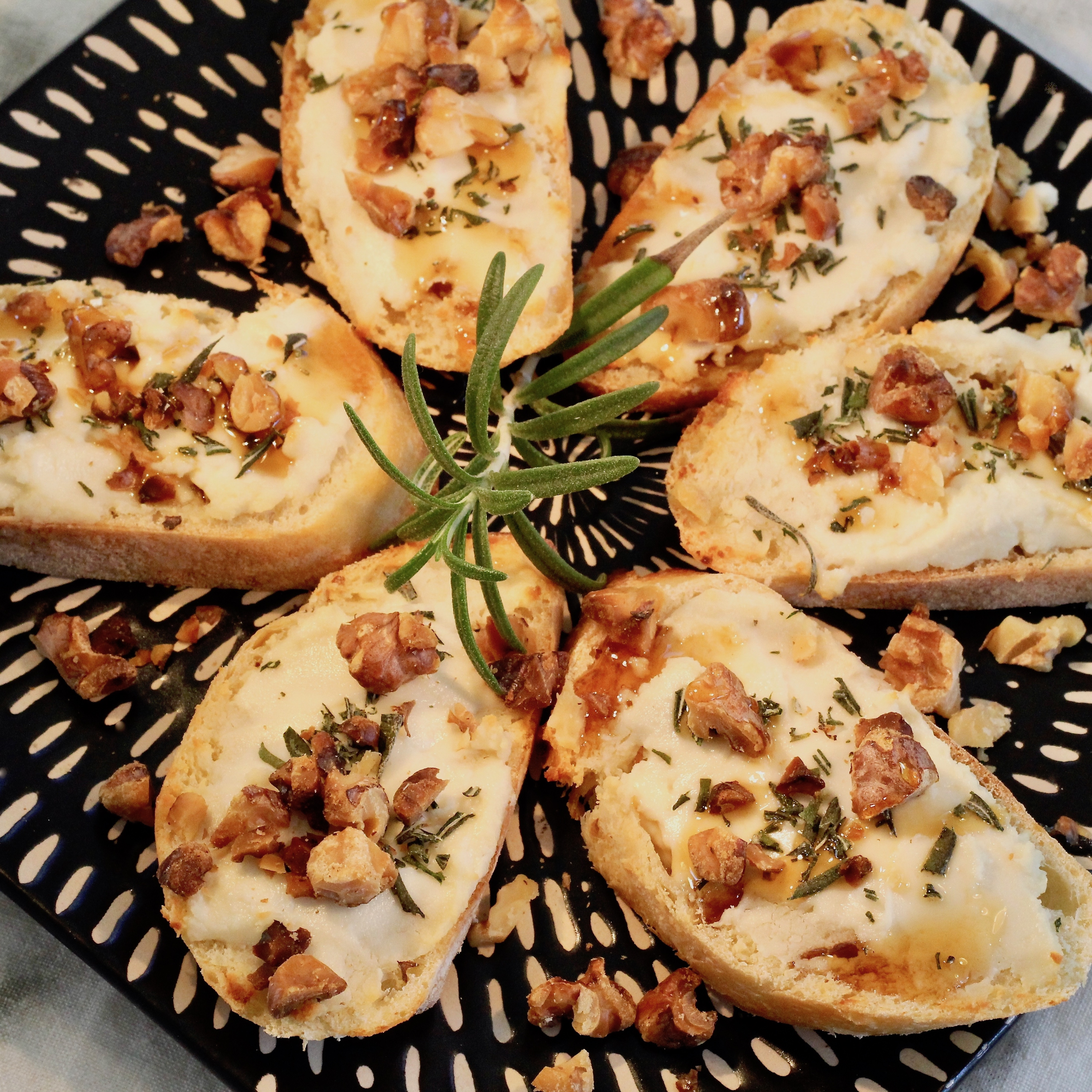 Rosemary and Goat Cheese Crostini with Walnuts and Honey