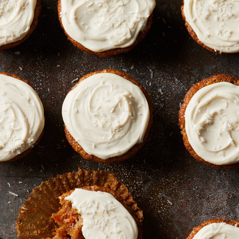 These moist and delicious cupcakes take on a hint of the tropics thanks to pineapple and coconut. Traditional cream cheese frosting is usually made with regular cream cheese and butter. This version is lightened up by substituting a combination of reduced-fat cream cheese and low-fat Greek yogurt.