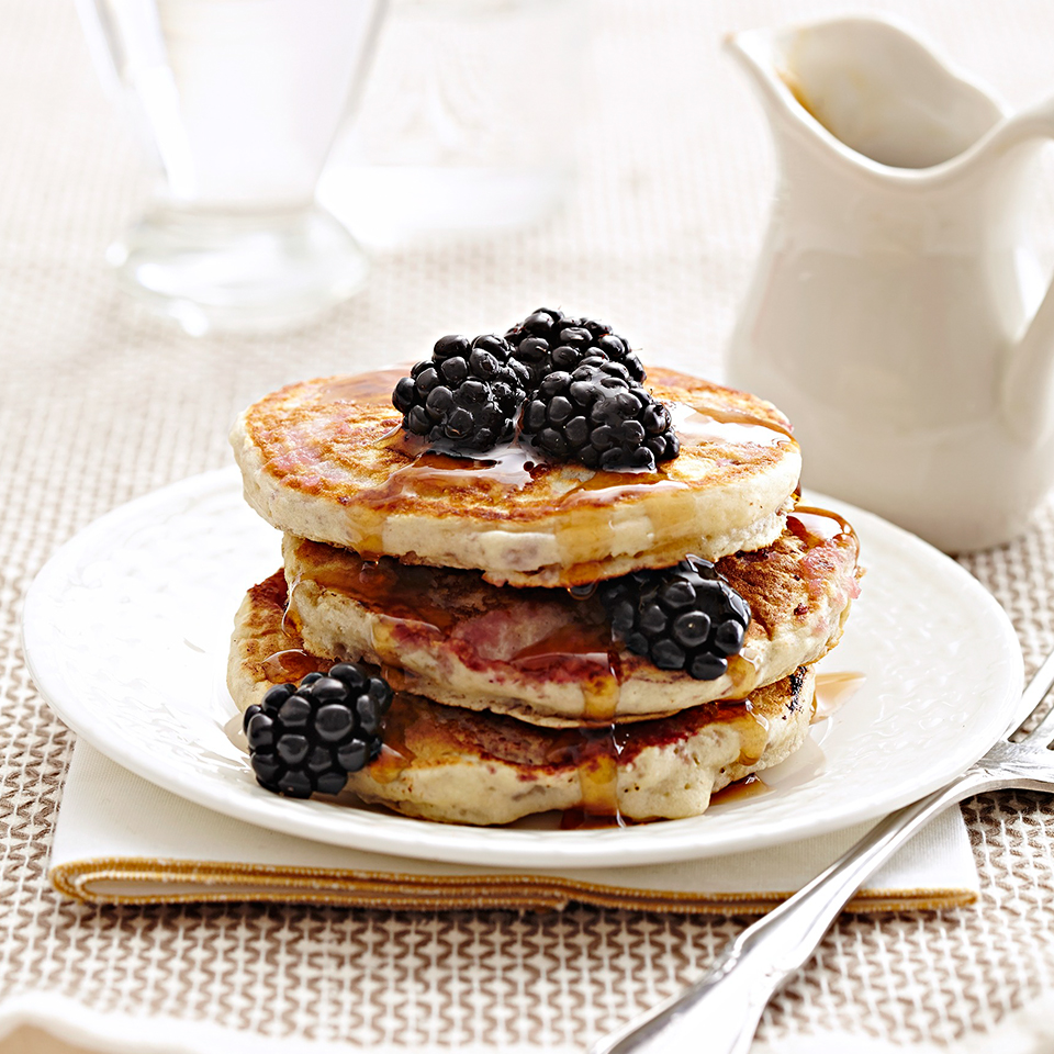 Adding applesauce to these Berry Swirl Pancakes ensures helps to reduce sugar content and ensures that they will be moist and delicious for breakfast.