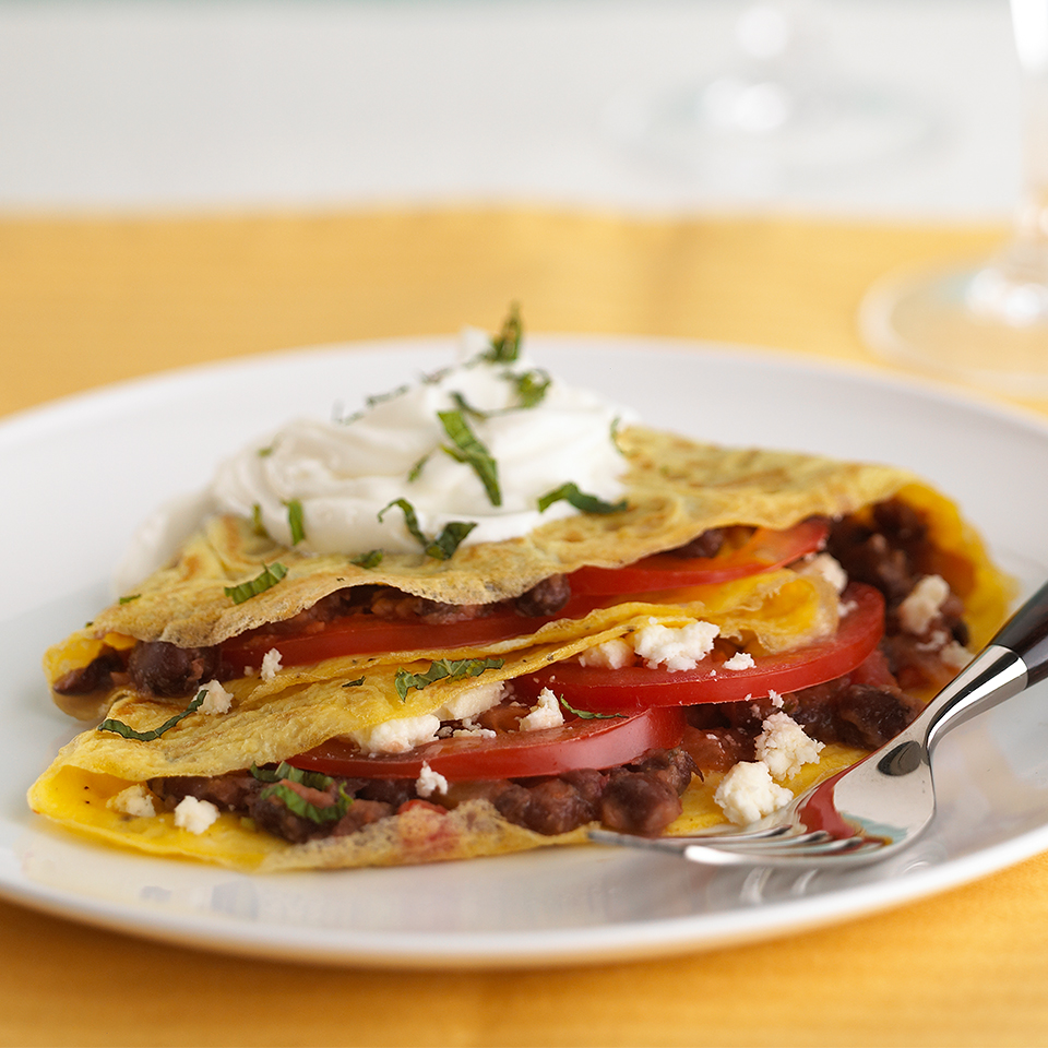 Mashed black beans, crumbled queso freso, fresh cilantro and chopped tomato give this easy breakast tostada a Soutwestern flair. Source: Diabetic Living Magazine