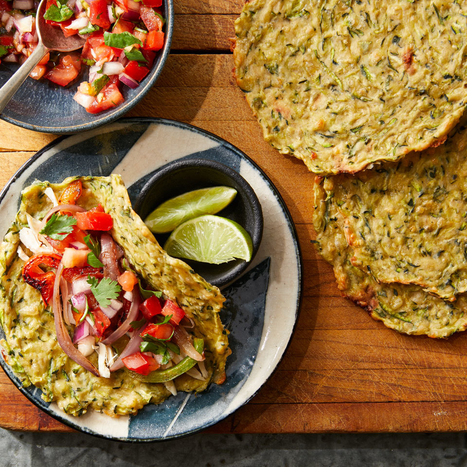 In this genius carb swap recipe, shredded zucchini held together with a little cheese creates a delicious gluten-free tortilla. These low-carb tortillas are delicious on their own as a snack, but you can also wrap them around your favorite tortilla fillings. Be sure to squeeze as much liquid as possible from the zucchini in Step 2, as this will yield crispy tortillas. Source: EatingWell.com, March 2018
