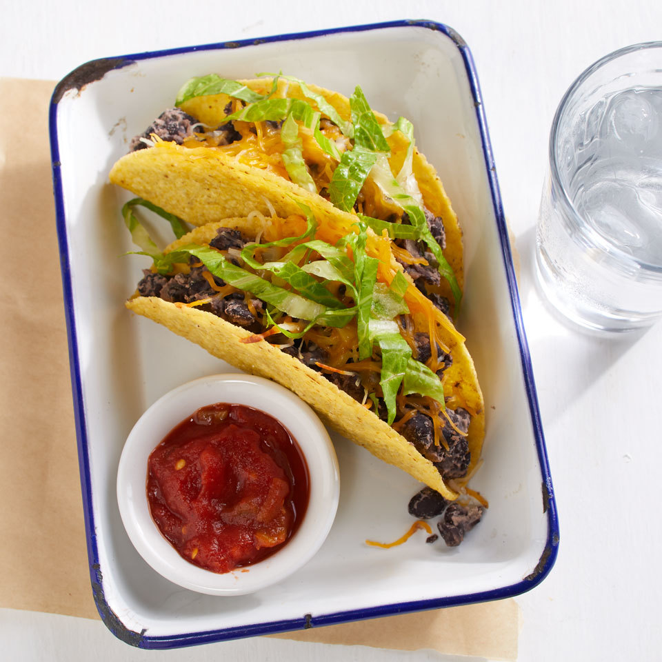 Mixing mashed canned beans with whole beans and seasonings makes an incredibly simple taco filling from your pantry. Top these speedy 5-ingredient tacos with lettuce, tomato and salsa or any of your favorite taco toppings. Source: EatingWell.com, March 2018