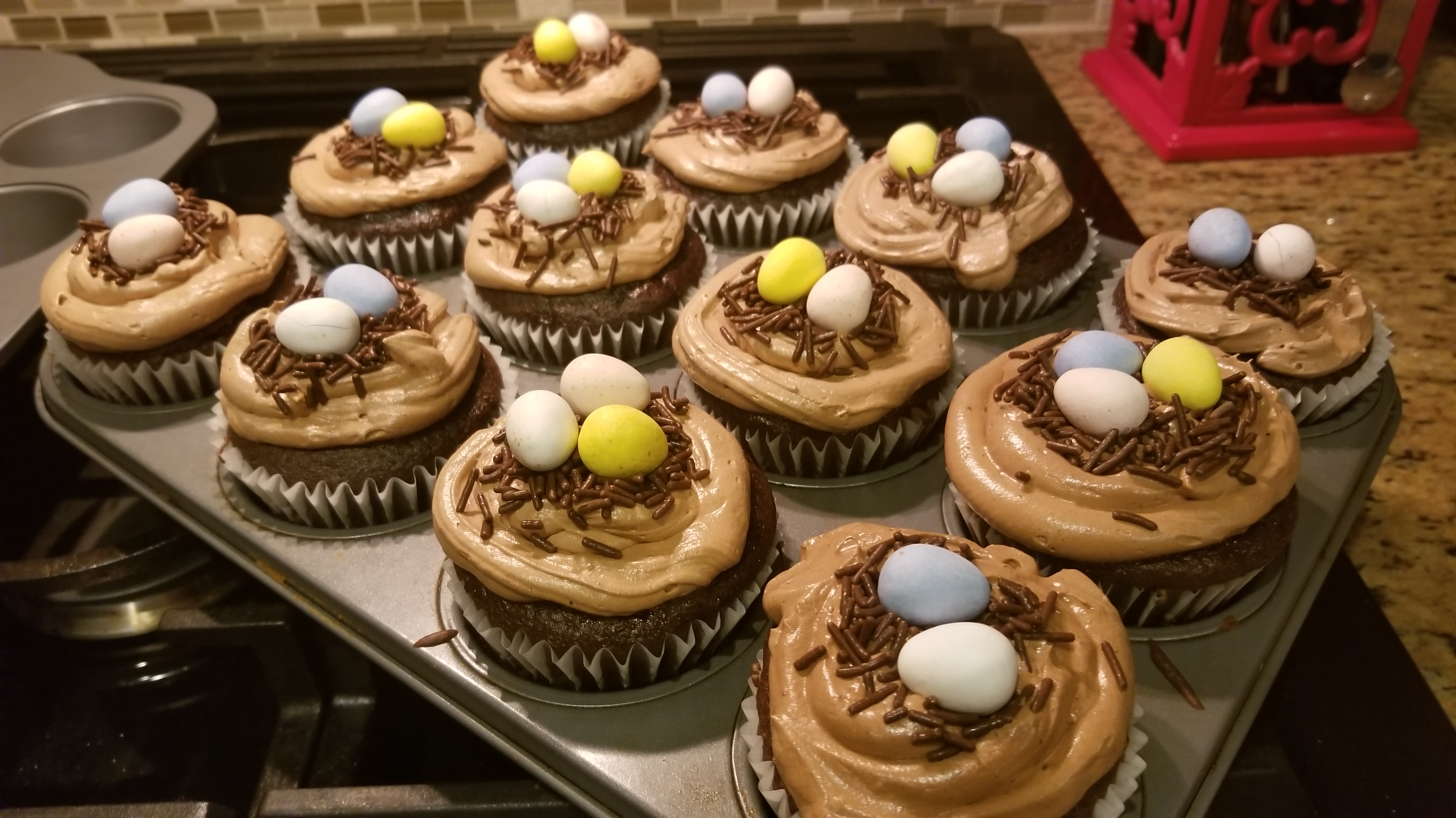 """Cupcakes with creamy chocolate surprise centers and a cute little Easter bird's nest on top of creamy chocolate frosting,"" says CC<3's2bake. ""Made these in honor of my daughter, Carlee."""