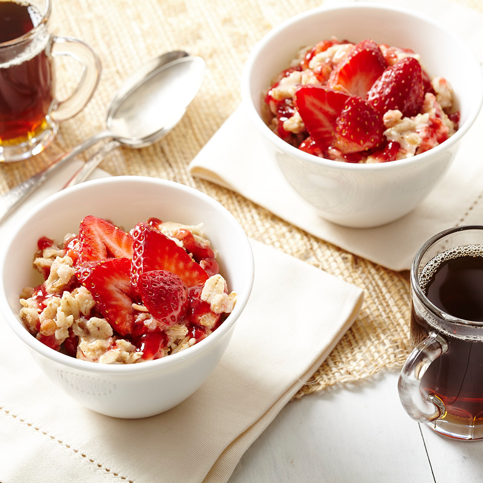 Creamy peanut butter and sliced strawberries with oatmeal is sure to brighten any morning.