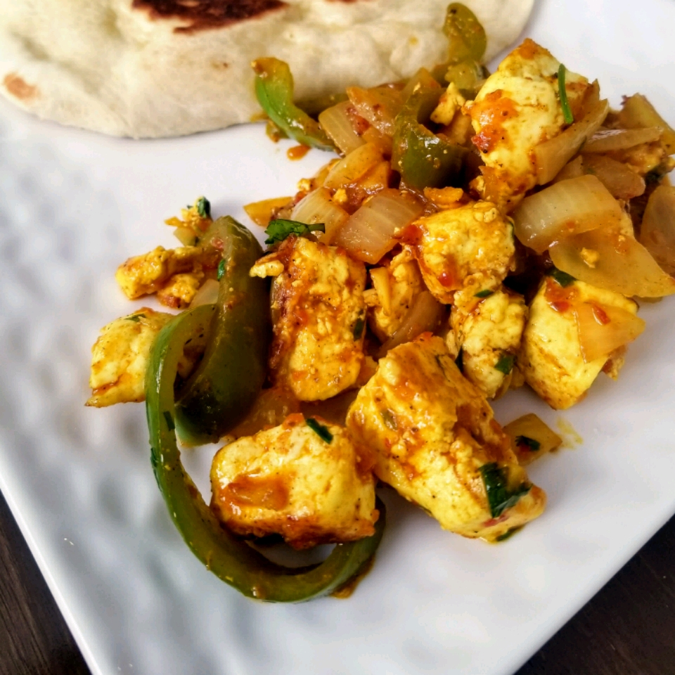 """An authentic jalfrezi curry, packed with cubes of fried paneer, green bell peppers, and onions. """"I love this recipe and have made it several times. Frying the cheese first is a crucial step. The fried cheese is so much better and it maintains its texture better in the sauce,"""" says reviewer Allison."""
