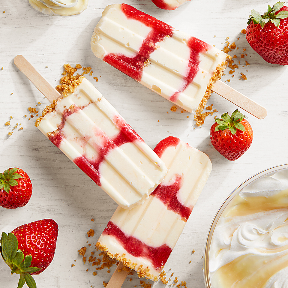 Cheesecake mix, graham crackers, and strawberries make this truly a cheesecake popsicle.