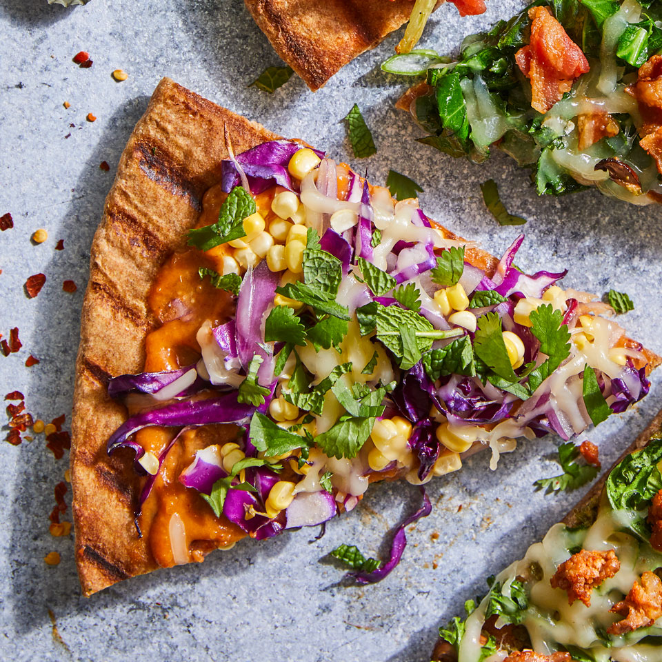 Thai peanut sauce is an addictive base for homemade grilled pizza. Purchase your preferred brand at any large supermarket or Asian grocery store for an easy, veggie-loaded pizza made right at home. Source: EatingWell Magazine, May/June 2018