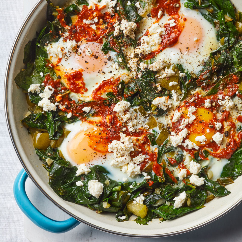 Shakshuka, or eggs poached in an aromatic tomato sauce, is a fast, one-pan breakfast staple in Northern Africa and Israel. This healthy recipe features spinach, herbs and tomatillos. Garnish with a touch of harissa--a fiery chile paste--and dip some toasted whole-grain country bread into the jammy yolks. Source: EatingWell Magazine, May/June 2018