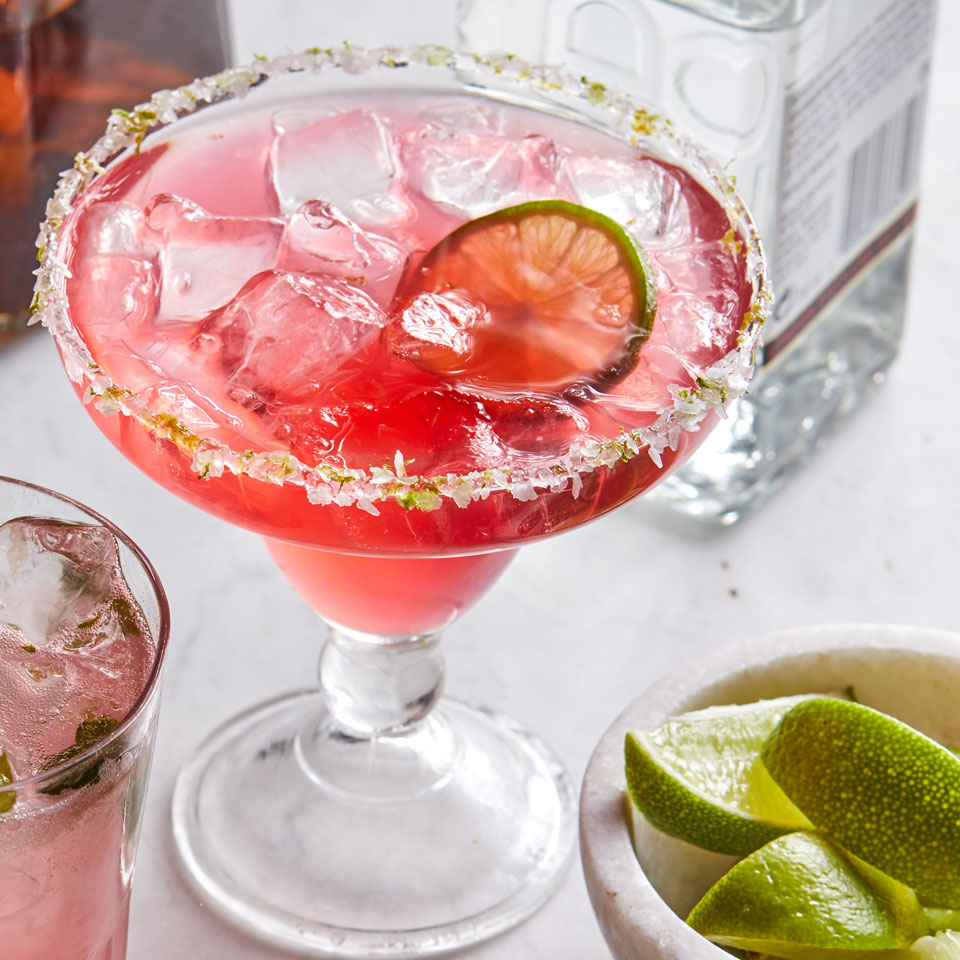 Amp up margarita night with a quick homemade simple syrup that packs a brilliant pink hue from dried hibiscus flowers. Serve with guacamole topped with pomegranate seeds and lime tortilla chips. Source: EatingWell Magazine, May/June 2018