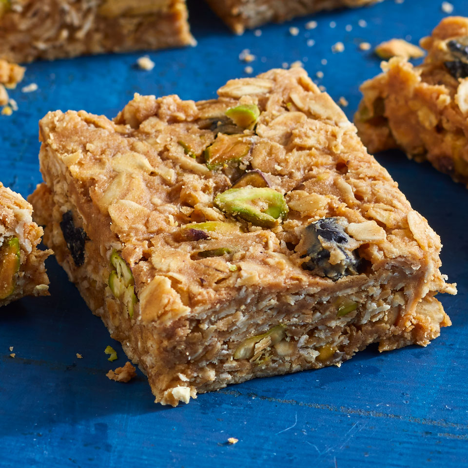 These one-bowl, no-bake energy squares ensure a quick way to refuel during long meetings, tough workouts or that mid-afternoon energy slump. Feel free to swap the blueberries for your favorite dried fruit and the pistachios for your favorite nut--but keep the maple syrup as is; we found using less than 1/2 cup resulted in crumbly bars.Source: EatingWell Magazine, May/June 2018