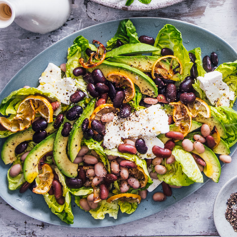 Creamy avocado, salty feta cheese and sweet-bitter caramelized lemon slices make this vegetarian bean salad recipe a standout. Using different colors, sizes and shapes of beans makes this salad extra special. But any bean that interests you, even canned, will work.