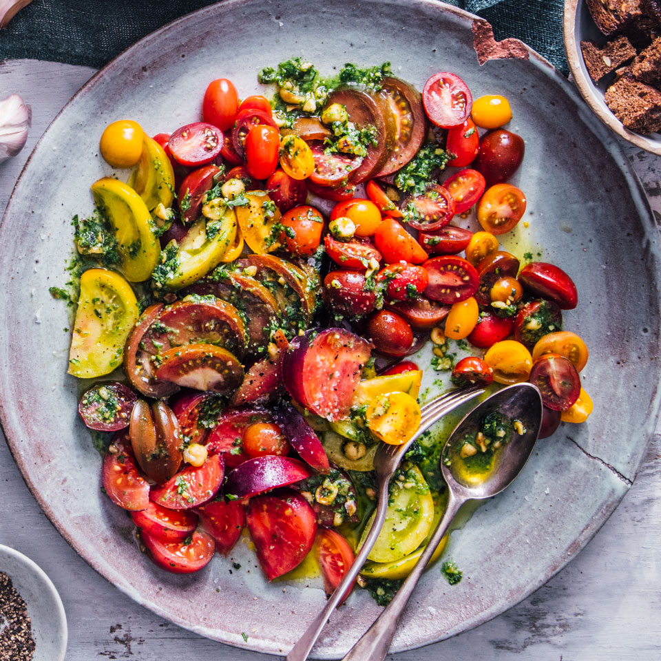 With this easy tomato salad, more is more--so if you want, go wild with an outrageous selection of tomatoes. Look for big gnarly tomatoes, plum-shaped varieties, smooth or peach-fuzzed skins, zebra stripes, not to mention the miniatures at the summer farmers' market. All the visual variation means you'll get a range of flavors as well. Source: EatingWell Magazine, May/June 2018