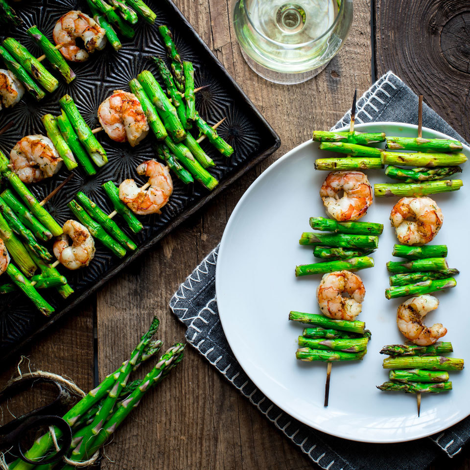 Shrimp and asparagus both cook very quickly, making them a perfect pair on the grill. We've seasoned them in delicate flavors--lemon, garlic and dill--so their natural sweetness can shine through. Pick fat asparagus stalks for easier skewering. Source: EatingWell.com, April 2018