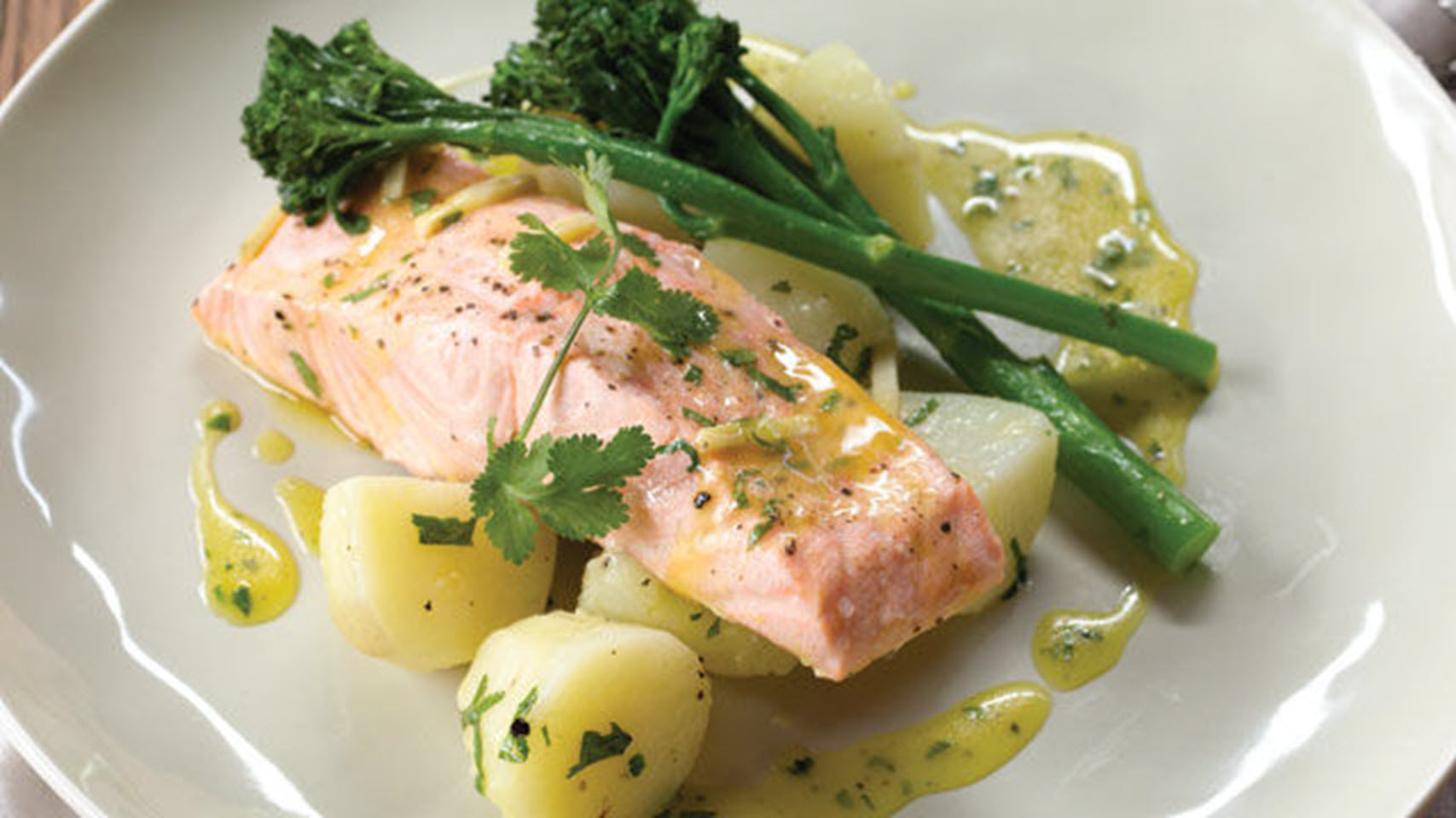"""Here is a complete meal with new potatoes, broccolini (or asparagus), and steamed salmon. """"Light but bursting with flavor,"""" says NPet. """"The perfect summer salmon recipe. Salmon and broccolini are steamed on a bed of lemon, ginger, and garlic with orange juice and served with new potatoes."""""""