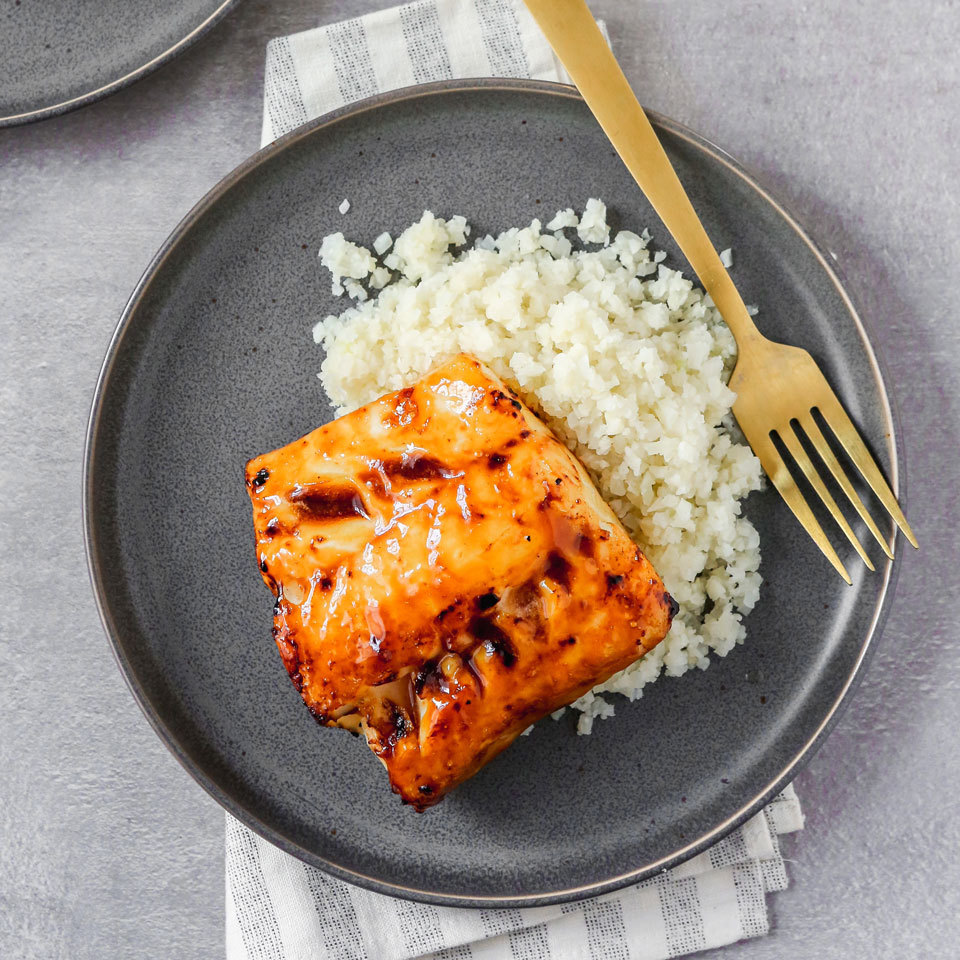 This healthy fish recipe comes together fast with just three ingredients you can always have on hand in your freezer and fridge. Store-bought teriyaki glaze makes a great marinade for cod that doubles as a sauce for the cauliflower rice.Source: EatingWell.com, April 2018