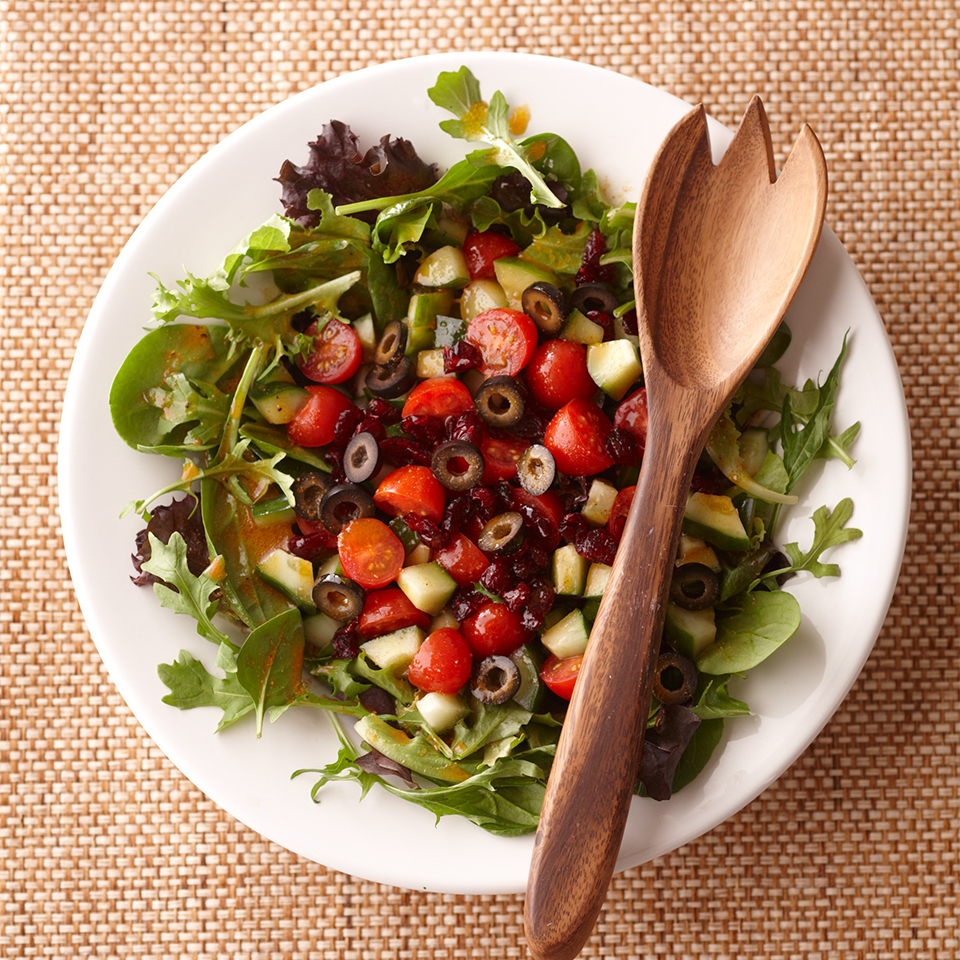 With a lot of low-calorie veggies, a slimmed-down dressing, and just a sprinkling of dried cranberries and olives, this colorful tossed salad comes up a nutrition winner.