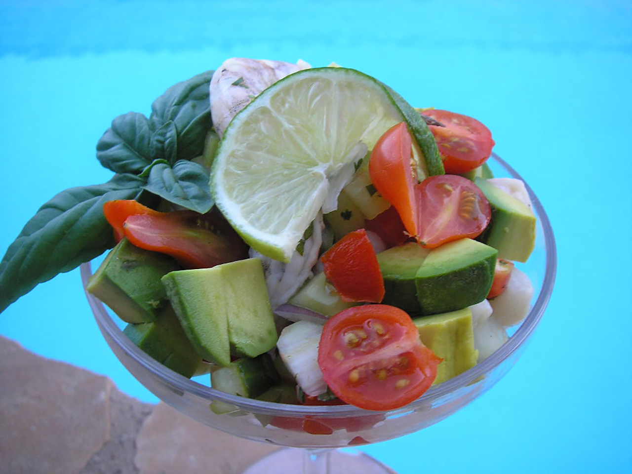 This is a super easy ceviche to try if you have never made ceviche before. Fresh shrimp, scallops, cilantro, chopped tomatoes, celery, green onions, serrano peppers, and a generous amount of lime juice are combined in a bowl, seasoned and chilled for 3 hours — that's it! Spoon into martini glasses for a nice presentation.
