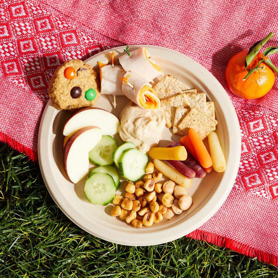 This colorful picnic dinner idea features tasty munchies you don't need utensils for and mild flavors that kids prefer, like deli meat, cheese and crunchy raw veggies. It's easy to assemble this complete menu, and adults will enjoy it as much as the kids. The menu calls for store-bought hummus and cookies, but you can easily make them yourself (see Tips, below).Source: EatingWell.com, May 2018