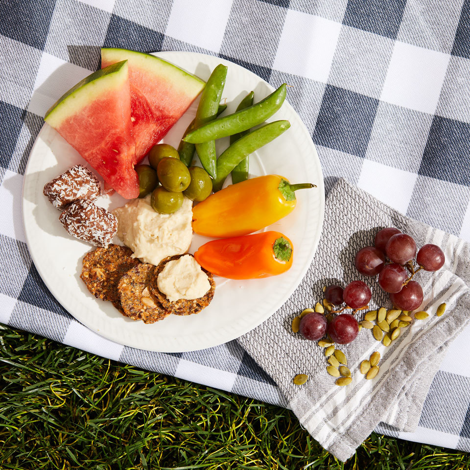 Fresh veggies with dip, juicy fruit and even a sweet treat make up this easy-to-make picnic dinner that's great for packing up or enjoying at home. Plus, this combo excludes the most common allergens and food intolerances (it's free from dairy, eggs, soy, nuts and gluten) so just about everyone should be able to enjoy it without worrying. Source: EatingWell.com, May 2018