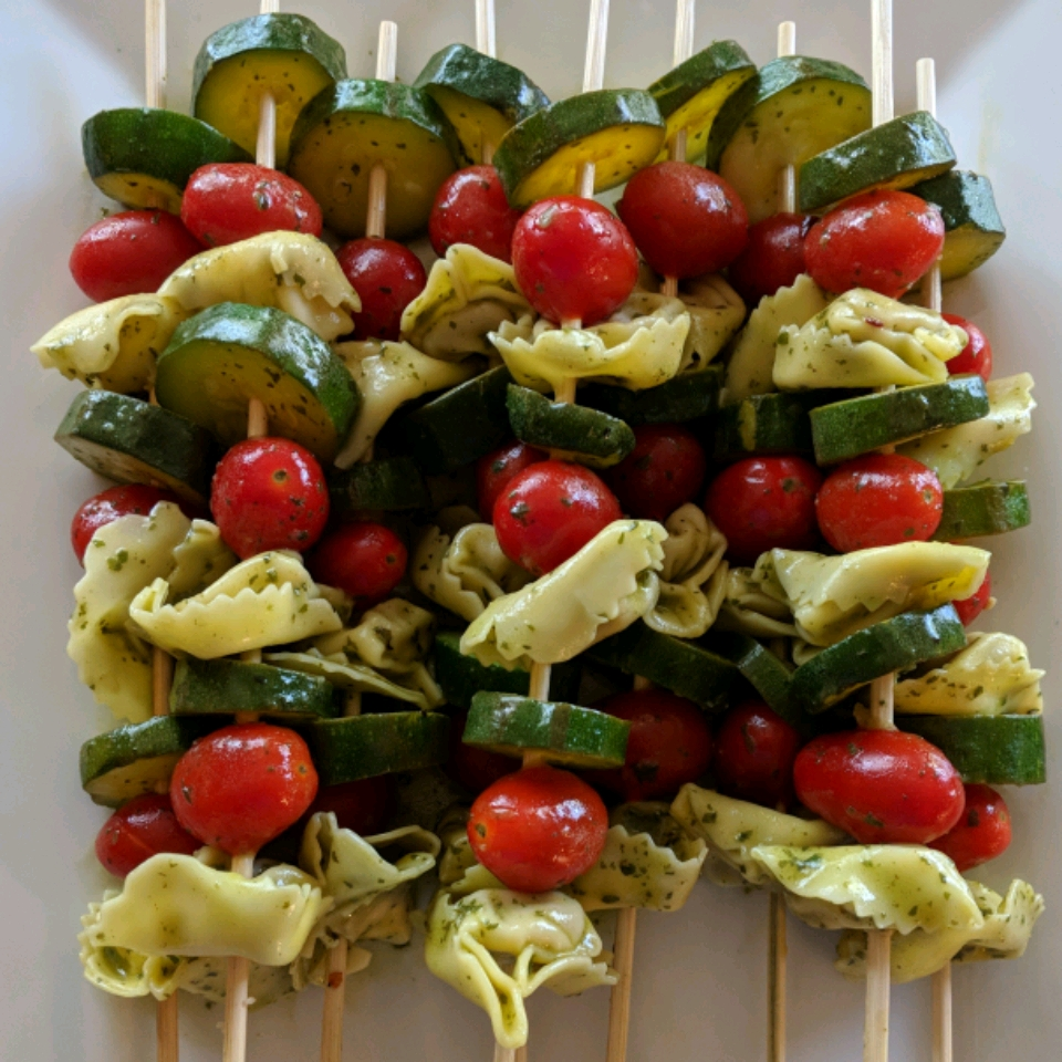 If you can boil water, you can make these simple yet toothsome appetizers. Prepare a package of refrigerated tortellini as directed, then rinse with cold water and toss with prepared pesto before skewering onto toothpicks with cherry tomatoes.