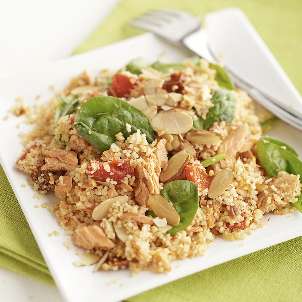 Salmon is tossed with couscous, spinach, and roasted red peppers, then topped with toasted almonds for a light and easy meal that's ready in less than 30 minutes. Source: Diabetic Living Magazine