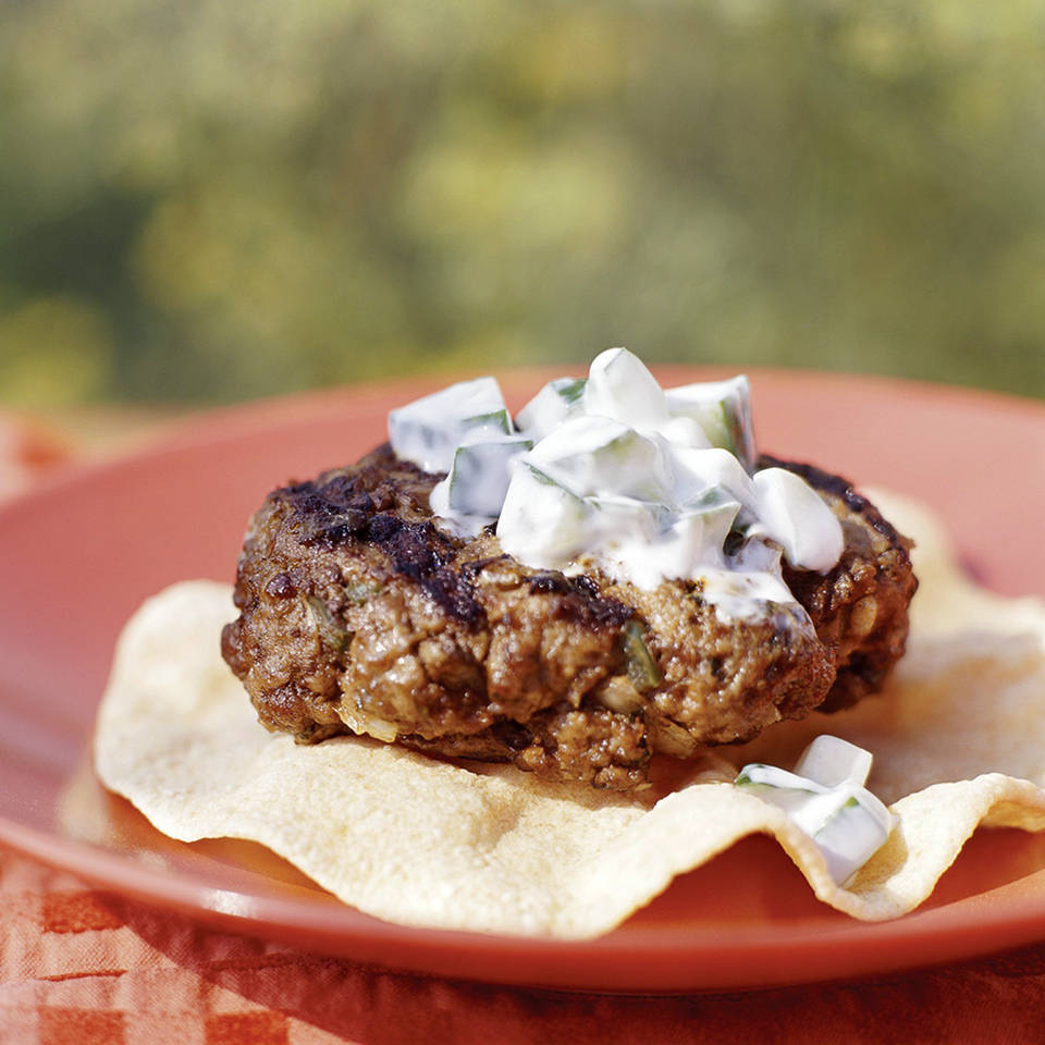 Tame these fiery mint- and cumin-spiked ground beef patties without derailing your daily meal plan when you add the cool low-fat cucumber sauce to them.