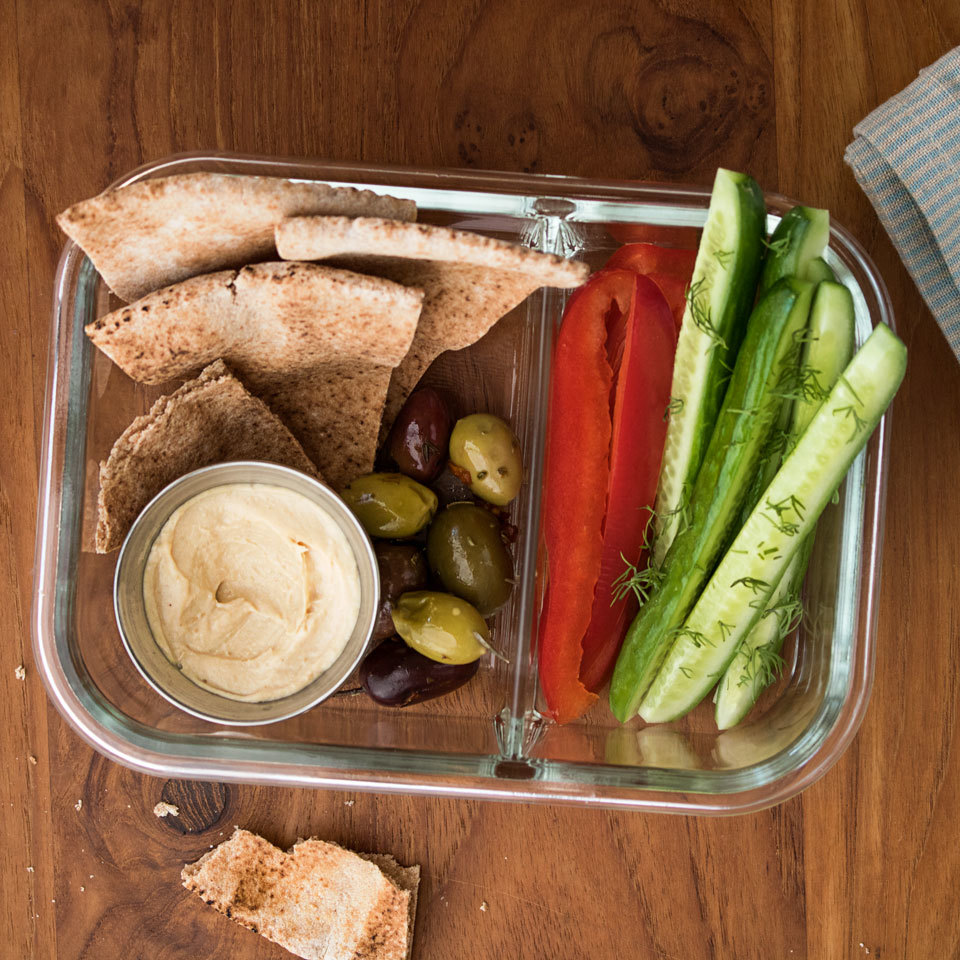 Perfect to pack for lunch to take to work or for a picnic in the park, this vegan bistro box is filled with Mediterranean diet-inspired crunchy vegetables, pita bread, creamy hummus and olives. Source: EatingWell.com, May 2018