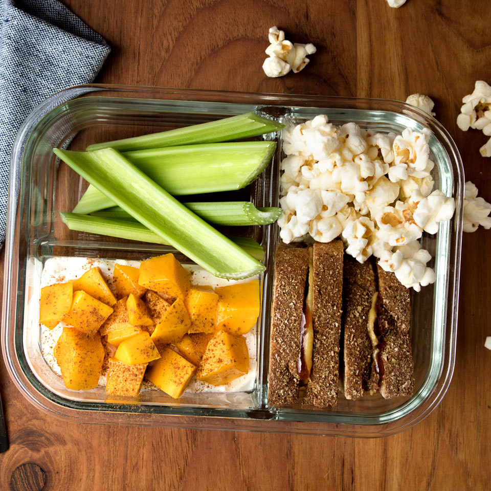 Inspired by Starbucks' bistro boxes, this peanut butter and jelly lunch will be loved by kids and adults alike. Accompanied by sandwich sides including a yogurt parfait, fruit, veggies and popcorn, this healthy packable lunch will keep you full until dinner. Source: EatingWell.com, May 2018