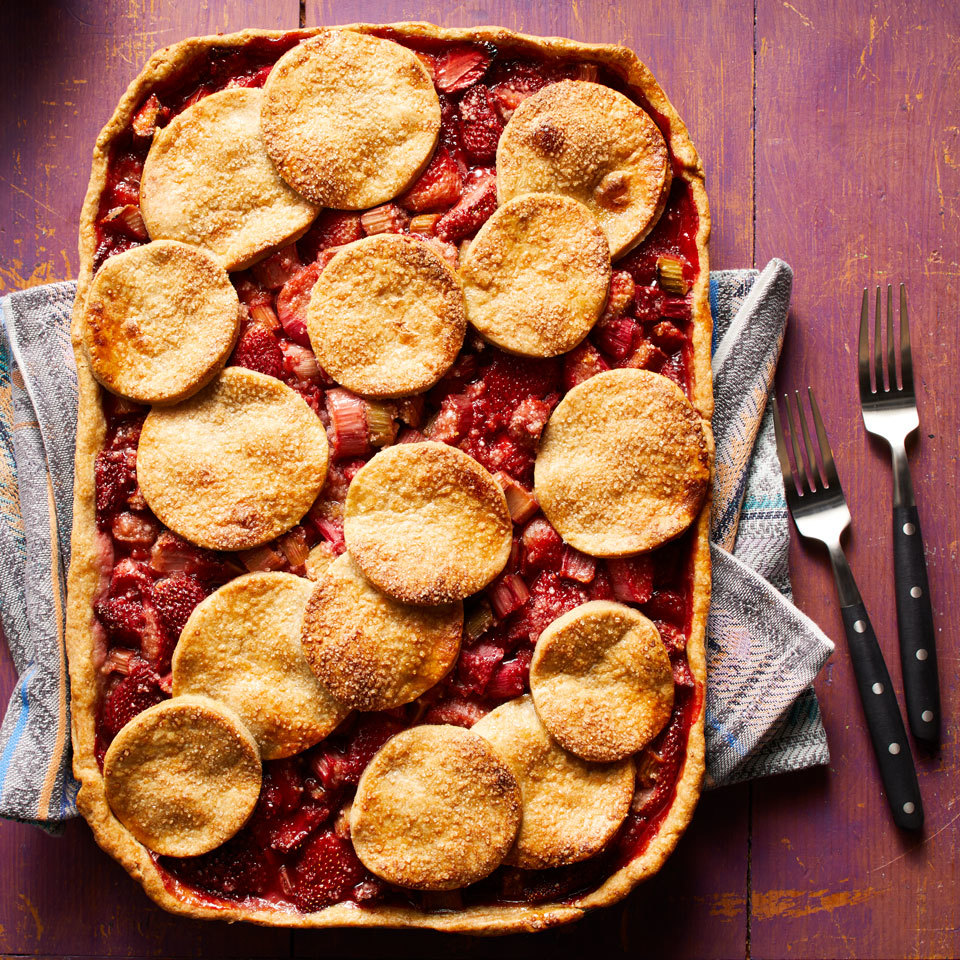 Sweet strawberries and tangy rhubarb nestle into a flaky, buttery crust for a pie so beautiful, you almost won't want to cut into it. A slab pie is the ultimate dessert for time-crunched cooks: it's baked right in a jelly roll pan and makes enough to serve a crowd. Source: EatingWell.com, May 2018