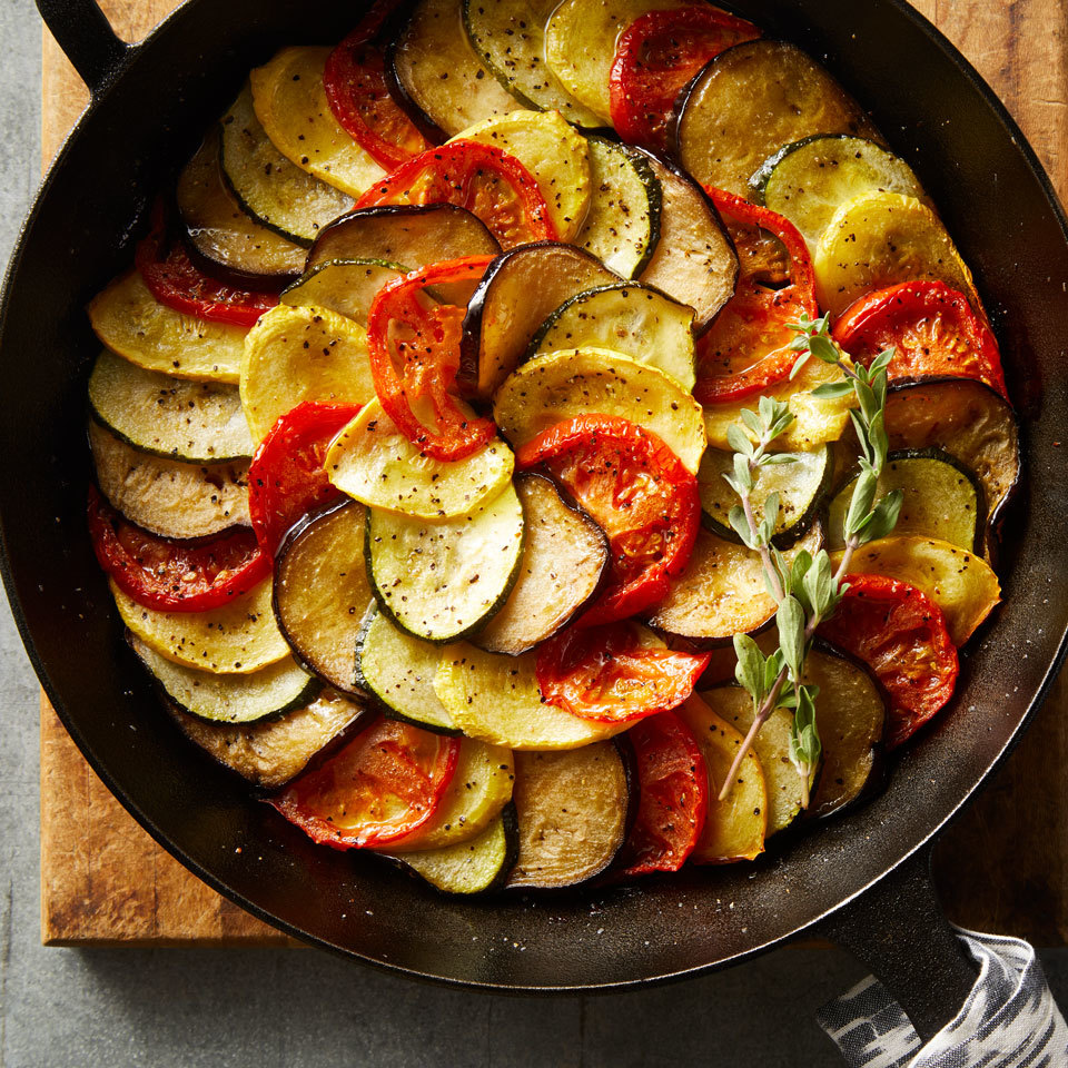 Ratatouille, a classic French dish with tomatoes, eggplant, zucchini, bell pepper and onion, is frequently cooked low and slow until it turns silky and luscious. We kept the classic flavor but gave it a makeover by thinly slicing the vegetables and layering them in a cast-iron pan. We brighten up the flavor at the end with a splash of red-wine vinegar. Source: EatingWell.com, May 2018