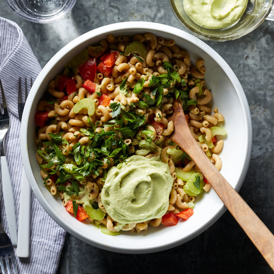 Give classic pasta salad a fresher, more flavorful spin. This fast pasta dish calls for avocado to replace some of the mayonnaise, which makes it extra creamy. Whole-wheat elbow macaroni and fresh vegetables lighten up this healthy pasta salad that you'll be making all summer long.