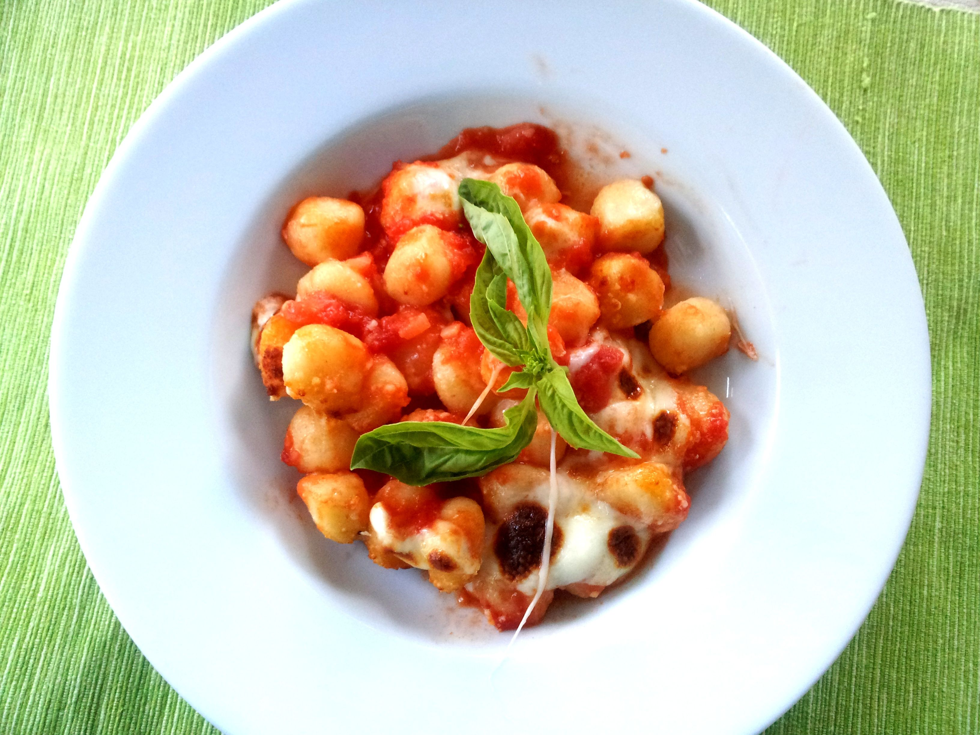 """This classic Italian dish starts with a package of potato gnocchi and canned crushed tomatoes. """"Known as 'gnocchi alla sorrentina,' this classic Italian pasta dish uses simple ingredients and tastes delicious,"""" says saretta. """"Use homemade or store-bought gnocchi."""""""