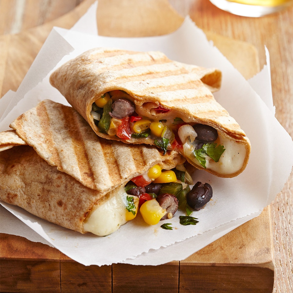 These easy wraps are filled with black beans, corn, red pepper and creamy queso. They cook up quickly in a panini press.