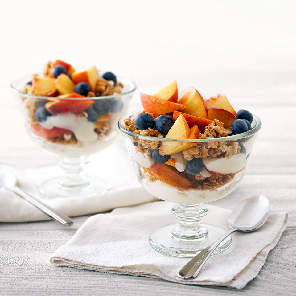 Layers of flavored yogurt, crunchy cereal, peach, and blueberries in a parfait glass make a quick but satisfying breakfast or snack. Source: Diabetic Living Magazine