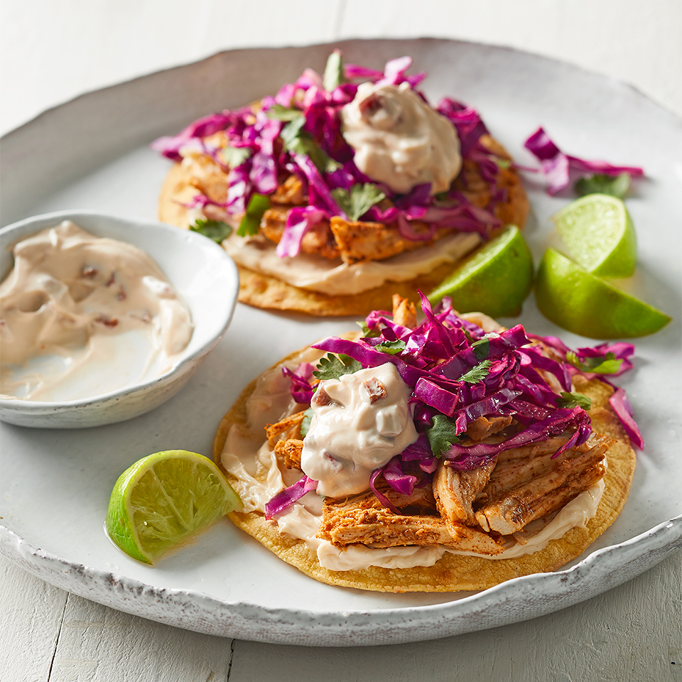 Mexican-inspired chicken tostadas are always a hit. Instead of full-fat cheese and fried tortillas, this recipe calls for light queso, toasted tortillas, and fat-free Greek yogurt. Source: Diabetic Living Magazine
