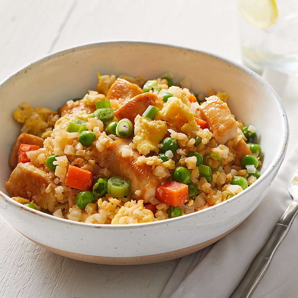 Cauliflower rice lends similar taste and texture to this Asian-inspired fried rice dish, but is lower in carbohydrates than real rice. Source: Diabetic Living Magazine