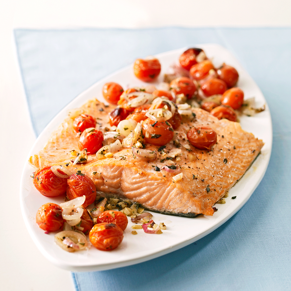 These salmon fillets are roasted on a juicy tomato-shallot mixture. This dish makes extra salmon that you can use for other entrees. Source: Diabetic Living Magazine