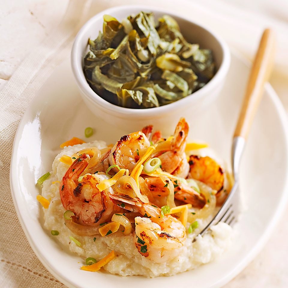 Onion and garlic season the shrimp, which is served on a bed of grits and topped off with cheese and green onions in this simple recipe.