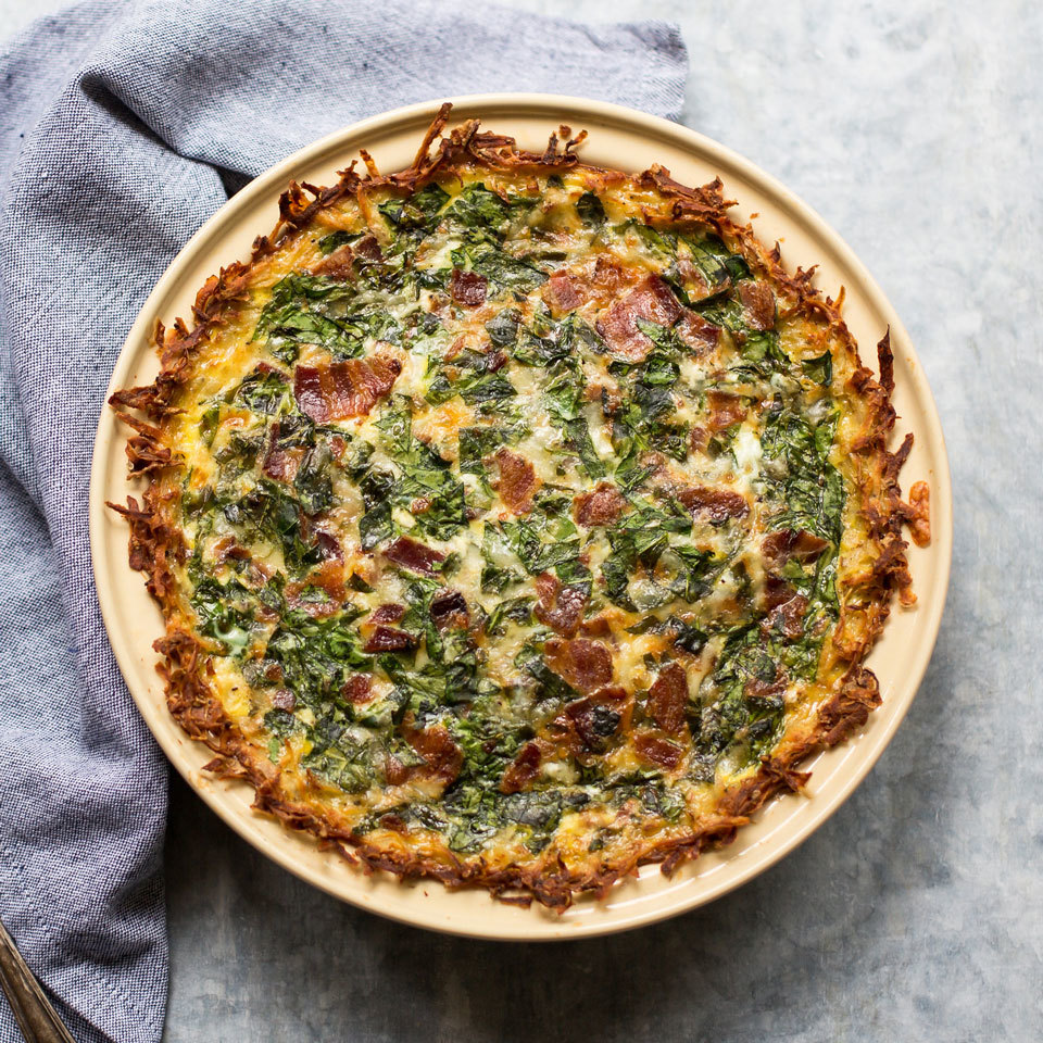 Hash browns meet quiche in this healthy recipe. Shredded potatoes create a gluten-free crust for this bacon and spinach-studded quiche that's sure to be a crowd-pleasing breakfast or brunch. Source: EatingWell.com, June 2018