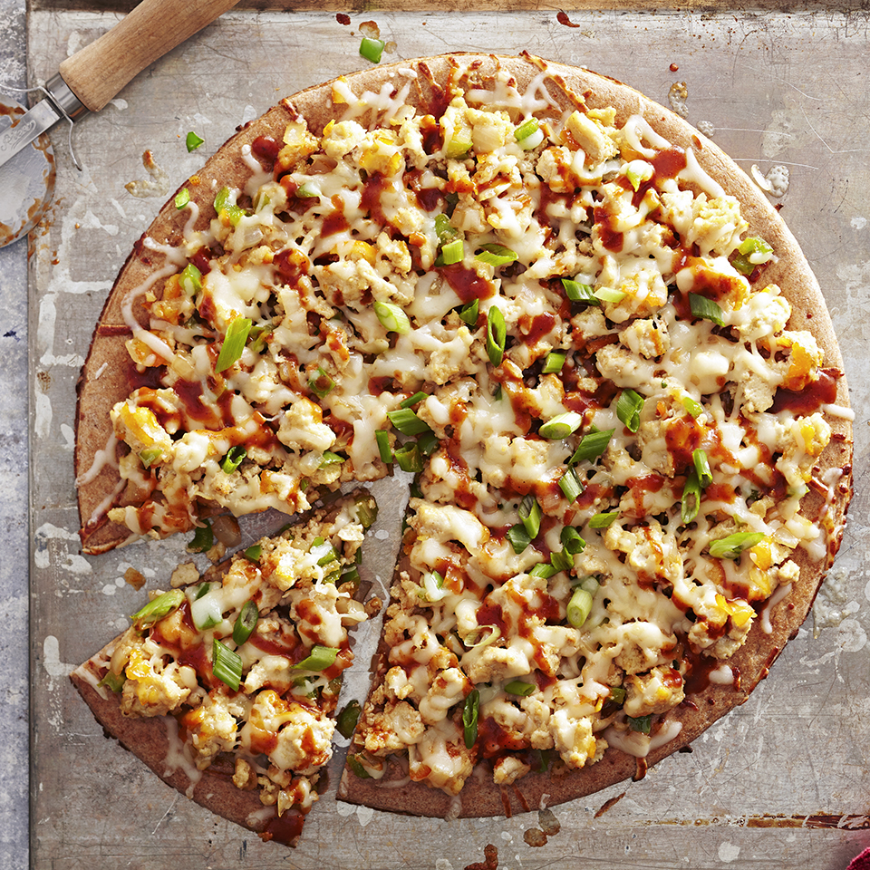 Barbecue-flavored chicken with peppers is baked on a premade pizza crust and topped with cheese for a quick and easy meal with lots of flavor. Source: Diabetic Living Magazine