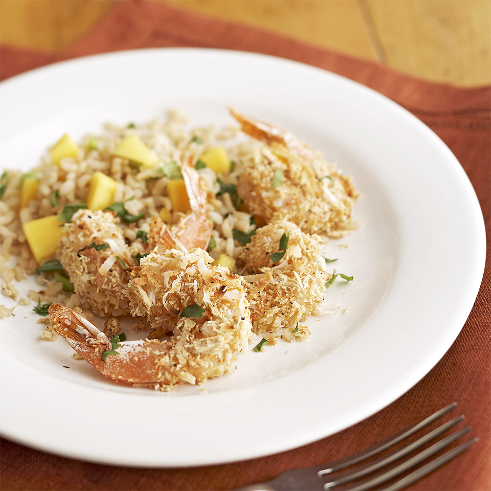 This island-inspired dinner features coconut-crusted shrimp alongside a fresh mango and herb-infused rice pilaf. Using packaged cooked brown rice is the secret to keeping the prep time short for this easy rice pilaf recipe.