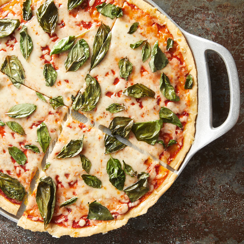 You won't believe how quick and easy it is to make this healthy pizza. Thanks to a two-ingredient dough that combines self-rising flour and Greek yogurt, there is no need for a rise time. Just roll, top and bake, and you'll have a delicious dinner on the table in under half an hour.